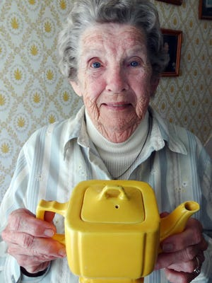 Kathryn Glenn, 92, of Saxis Island holds a teapot used to entertain special guests at the former island school in 1941. The school had no kitchen, refrigerator, dining room or running water.