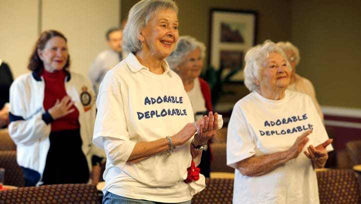 Jan Abbott, left, and Mellen Kolb, both residents of The Kenwood by Senior Star applaud as the National Anthemn is sung during Donald Trump's inauguration Friday January 20, 2017.