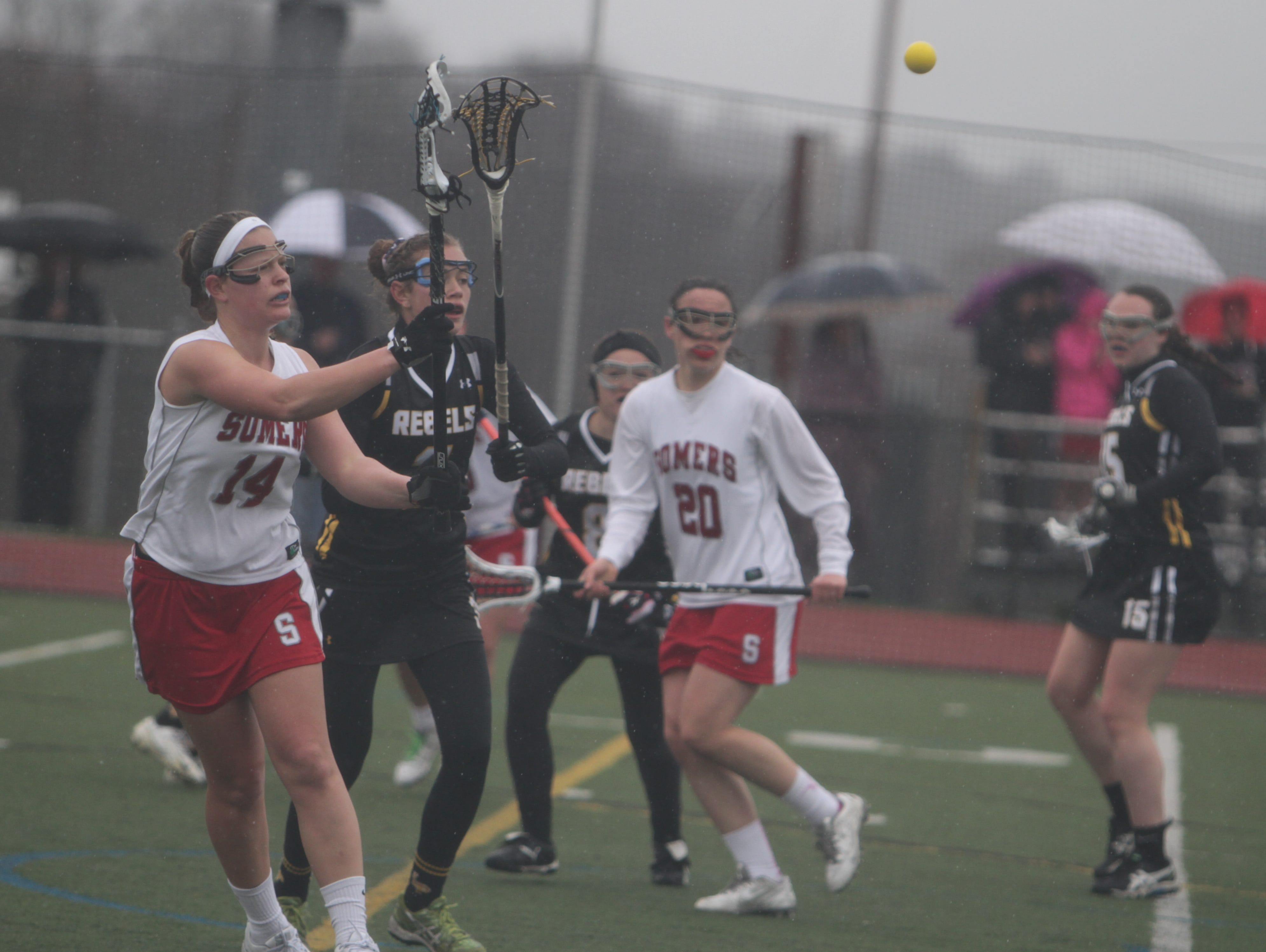 Somers' Izzy LaRocca (14) receives a pass during a Section 1 girls lacrosse game against Lakeland/Panas at Somers High School on Monday, March 28th, 2016. Somers won 15-8.