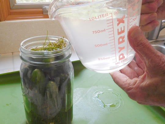 Pack the cucumbers (cukes) tightly in a jar and pour