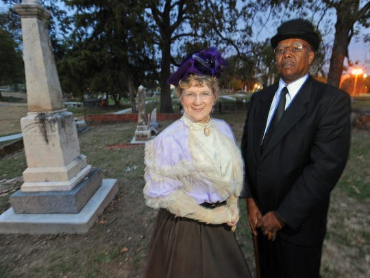 Jan Pettiet and Lee Marvin Adams pose in period costume at Oakland Cemetery in Shreveport.