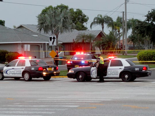 Cape Coral police block off Skyline Boulevard at Cape Coral Parkway where police shot and killed a gunman accused of killing two Sunday night.