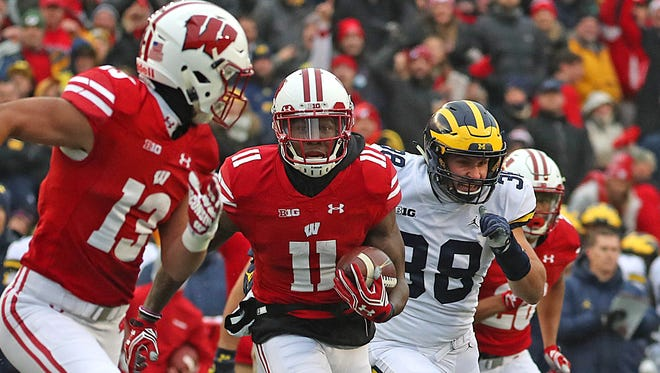 Nick Nelson gets Wisconsin on the scoreboard with a 50-yard punt return for a touchdown in the first quarter against Michigan on Saturday in Madison.