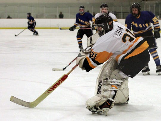 Hendersonville goalie  Jacob Shaw flips the puck away