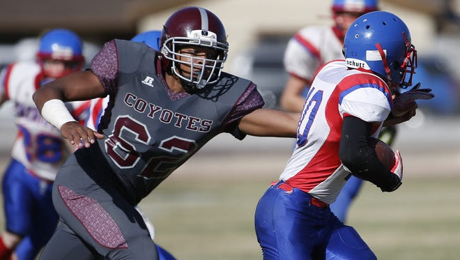 Desert Heights Prep's Deontae McInnis, left, tackles James Madison's Nolan Payne during the Canyon Athletic Association Division 1 state championship game in November.