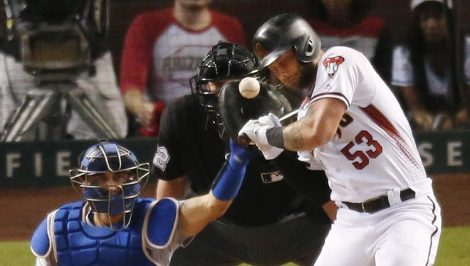 Arizona Diamondbacks first baseman Christian Walker (53) is hit by a pitch by Los Angeles Dodgers starting pitcher Yu Darvish (21) during the sixth inning of game 3 of the NLDS at Chase Field in Phoenix, Ariz. October 9, 2017.