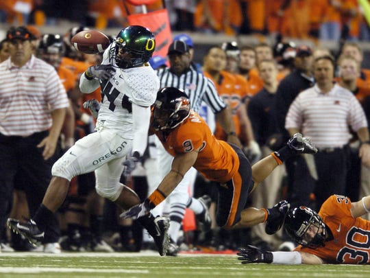 Jeremiah Johnson bobbles the ball but regains control on an 83-yard touchdown run as Oregon and Oregon State battled in the Civil War in Corvallis on Nov. 29, 2008.