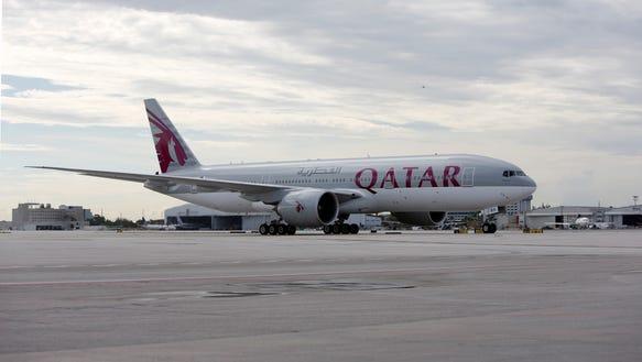 AP_QATAR_AIRWAYS_MIAMI_TOUCHDOWN_64897834