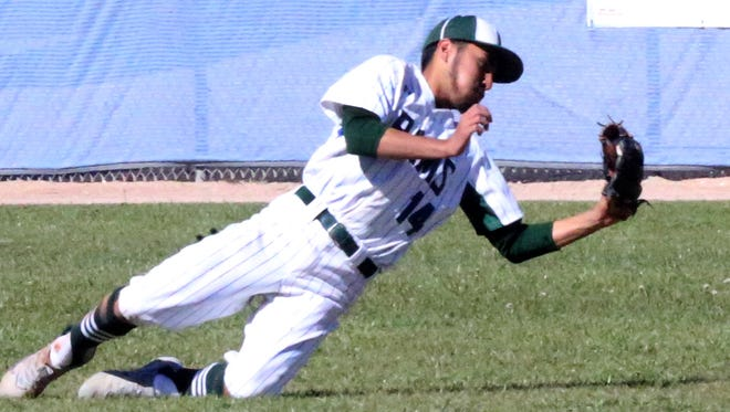 Montwood outfielder Peter Mirano makes a falling catch against Americas earlier this season.