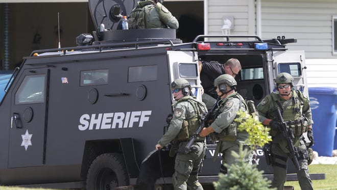 Police arrested a 55-year-old man after a nearly three-hour standoff Tuesday on Spring Meadow Drive in Town of Menasha.