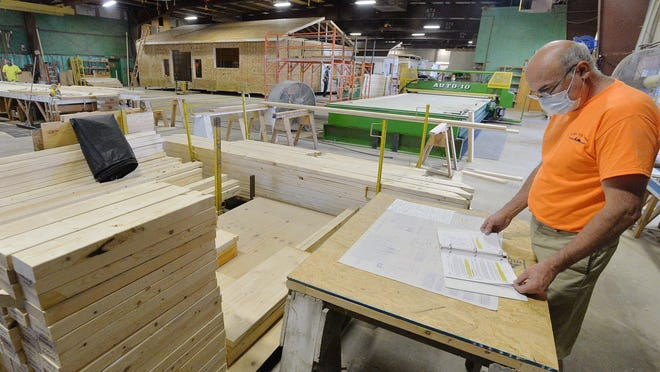 Lake City Housing truss builder Don Gabel, 56, works inside a company warehouse in Lake City. The workforce there has increased by six this year.
