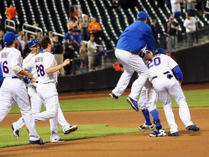 May 26: The Mets celebrate the walk-off single by shortstop