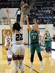 May's Kelsie Gage shoots a 3-pointer over Klondike's
