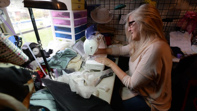 Jane Ryder spends much of her time in her workshop creating hats and costumes for clients and the local film industry.
