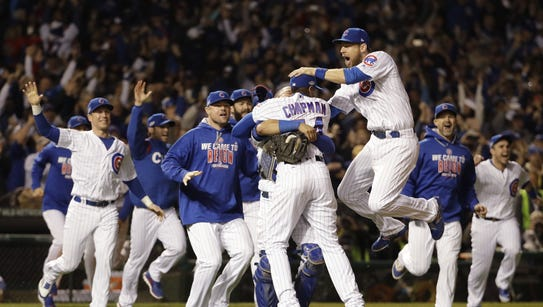 Chicago Cubs players celebrate after Game 6 of the