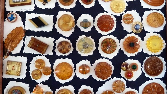 Buttons made from Bakelite, an early plastic popular in the 1920s and 1930s, are displayed in a collection.