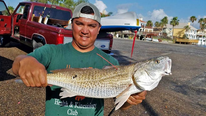 Jose Mendoza, a World Geography teacher and coach at Carroll, caught one of three CCA-STAR tagged redfish and will win a pickup/boat package.