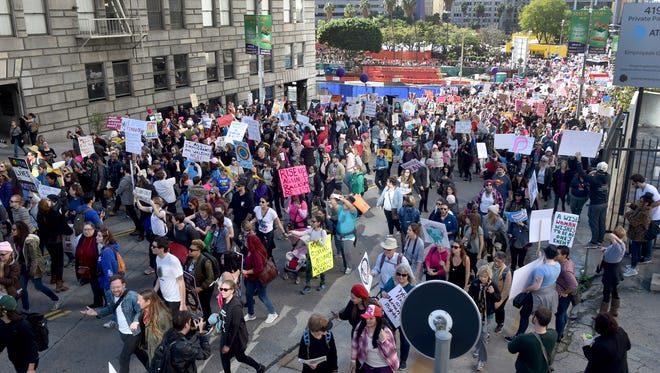 Thousands of people march in the streets of downtown Los Angeles on Saturday.