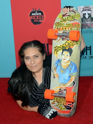 """In this Sunday, Oct. 5, 2014 file photo, Rose Siggins attends the premiere screening of 'American Horror Story: Freak Show.' A representative says the actor, who played the """"Legless Suzi"""" character on the show, died Saturday."""
