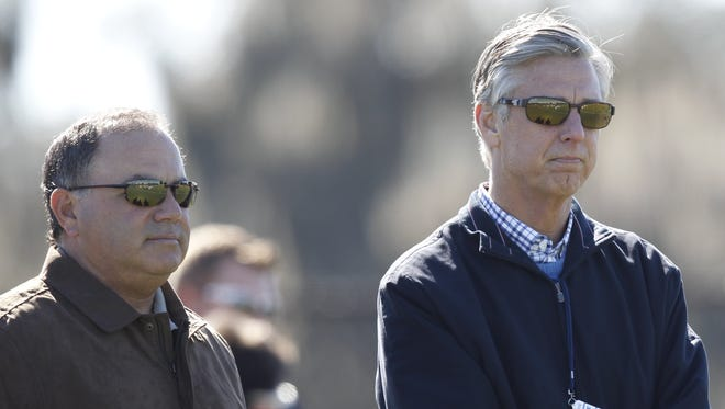 Detroit Tigers assistant general manager Al Avila and GM Dave Dombrowski, right, watch workouts in Lakeland, Fla., on Feb. 14, 2014.