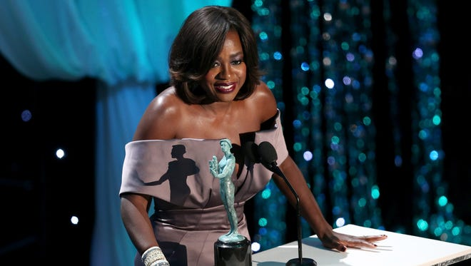 """Actress Viola Davis accepts the Female Actor in a Drama Series award for 'How to Get Away with Murder."""""""