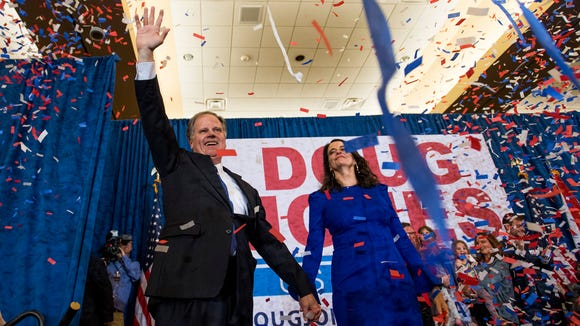 U.S. Senator elect Doug Jones and his wife Louise greet supporters as he claims victory at his watch party in Birmingham, Ala. on Tuesday December 12, 2017.