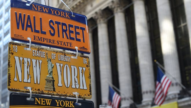 This file photo taken on Jan. 25, 2017 shows novelty license plates for sale in front of the New York Stock Exchange on Wall Street in New York.