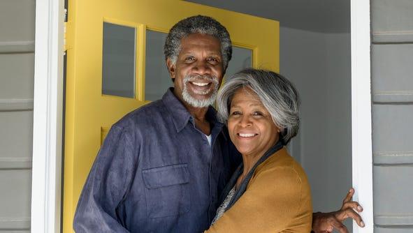 Couple standing by front door