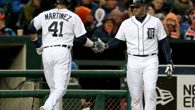 Detroit Tigers DH Victor Martinez is met by catcher Alex Avila after scoring against the New York Yankees on April 22,2015 at Comerica Park in Detroit. Both are currently on the disabled list but are making improvements in their rehabs.