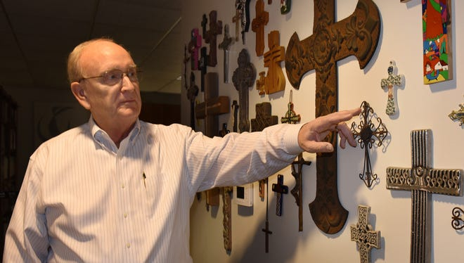 The Rev. Richard Henderson was planning on packing up this collection of crucifixes that he's collected over the decades of leading Novi's Faith Community Presbyterian Church. Many of the crosses came from other countries to which Henderson has traveled as a missionary.