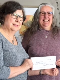 Arlene Danielson, president of Alpha Delta Kappa, presents check in support of Whisper Hill Clydesdales to Sue Reich, Volunteer organizer for Whisper Hill.