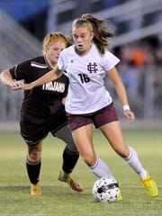 Henderson County's Katie Bickers (16) moves the ball
