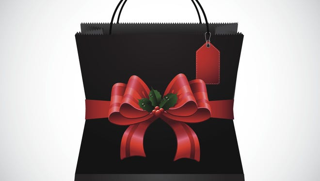 Black shopping bag with big red bow.