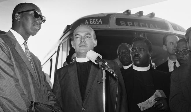 The Rev. Robert Stone, center, of New York City, speaks June 13, 1961, at a Washington, D.C., bus station before leaving on an expedition through the South with the newly formed Freedom Riders challenging racial barriers. The group was made up of seven African Americans and 11 whites who were protestant ministers or rabbis. At left is the Rev. Perry A. Smith of Brentwood, Md. The Rev. George Leke is at right. The group boarded a regularly scheduled Greyhound bus bound for Miami.