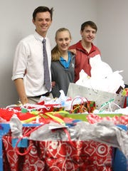 Jackson Wallace (from left), Meredith Kirkland and Blake Herbst