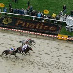 Exaggerator with Kent Desormeaux aboard wins the 141st Preakness Stakes horse race as Cherry Wine (1) with Corey Lanerie atop and Nyquist (3) with Mario Gutierrez aboard come in at Pimlico Race Course, Saturday, May 21, 2016, in Baltimore.   (AP Photo/Patrick Semansky)