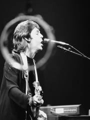 A Halo-like out-off-focus Tambourine circles head of former Beatle Paul McCartney on Monday, May 24, 1976, as he performs with this rock group 'Wings' at New York's Madison Square garden. The Performance was the first in a two-night stand at the garden for McCartney and his group who are touring the U. S.