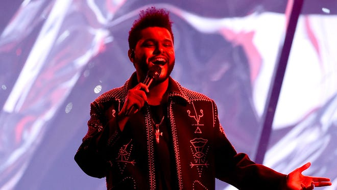 Recording artist The Weeknd performs onstage during the 2016 American Music Awards at Microsoft Theater on Nov. 20, 2016 in Los Angeles. The Weeknd will perform at the Firefly Music Festival in Dover, Del., in June, the festival announced Friday, Jan. 27, 2017.
