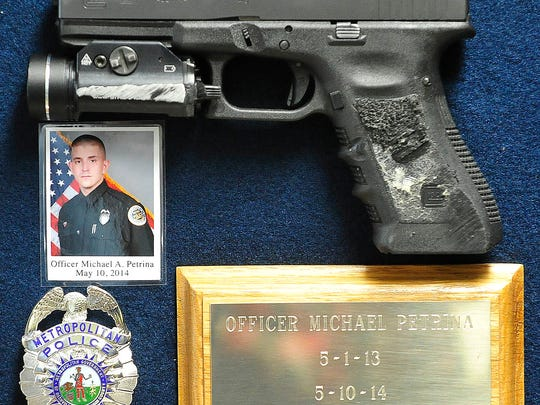 Fallen Metro Officer Michael Petrina's firearm was