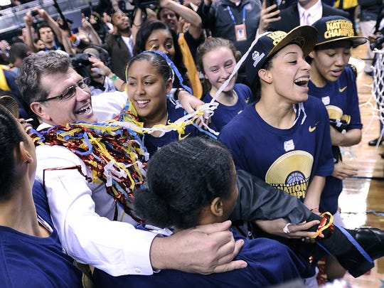 No. 3 Top 10 Sports Events: Connecticut head coach Geno Auriemma, left, is carried off the court by his players after defeating Notre Dame 79-58 in the championship game of the NCAA Women's Final Four tournament April 8, 2014 at Bridgestone Arena.