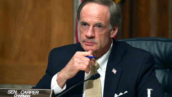 Then-Chairman U.S. Sen. Tom Carper (D-Del.) listens to testimony during a 2013 Senate Homeland Security hearing on Capitol Hill.