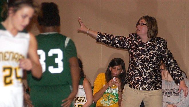 Former Menard girls coach Tonya McIntosh will return to the sidelines for the 2015-16 season at Buckeye.