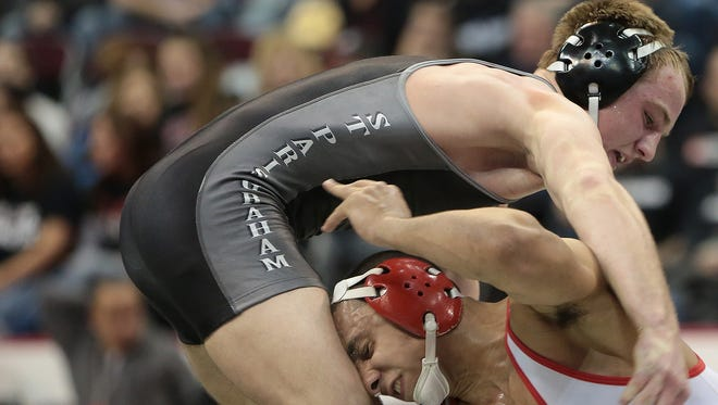 Three-time Ohio state champion Alex Marinelli (left) is the centerpiece of Iowa's recruiting class.