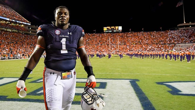Auburn defensive tackle Montravius Adams walks off the field against Clemson on Sept. 3, 2016.