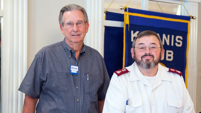 Don Paige, Community Services Chair of the Kiwanis Club of Abilene, presents a $750 donation to Major Russ Keeney, of the Salvation Army.