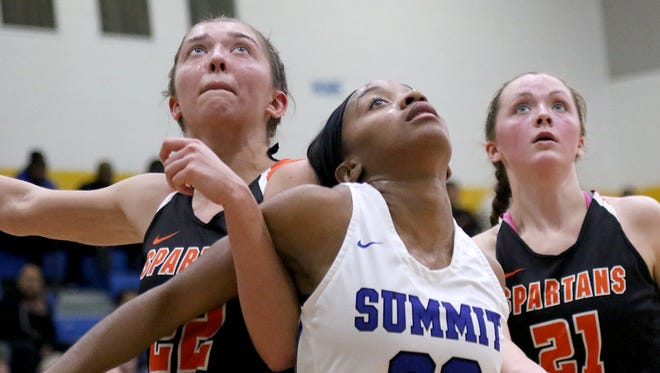 Summit Country Day's Niah Woods (30) battles Waynesville's Taylor Rittler for a rebound.