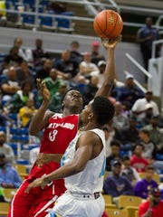North Caddo's Christavious Thomas shoots against Madison Prep's William Loyd during their play-off game in the LHSAA Boy's Top 28 Semi-Finals in Lake Charles March 10, 2016.