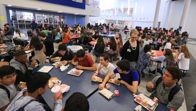 Jody Houston, food services director for the Corpus Christi Independent School District, observes choices students are making during lunch on Monday, February 22, 2016, at Veterans Memorial High School. She was chosen as one of five 2016 School Nutrition Heroes.