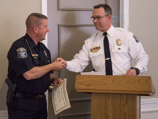 Officer of the Year Tony Angelosanto accepts honors