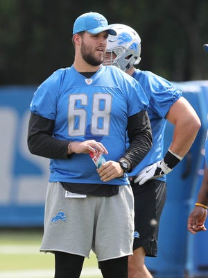 Lions tackle Taylor Decker watches drills during practice Sunday, July 30, 2017 in Allen Park.